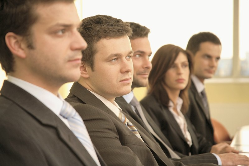 group of business persons at a conference, man in